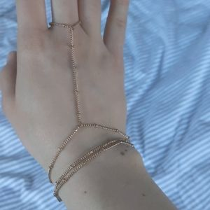 Gold toned chain bracelet and ring